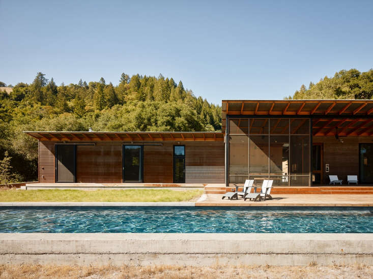 The lap pool is made of standard gunite, with a raised perimeter of board-formed concrete.