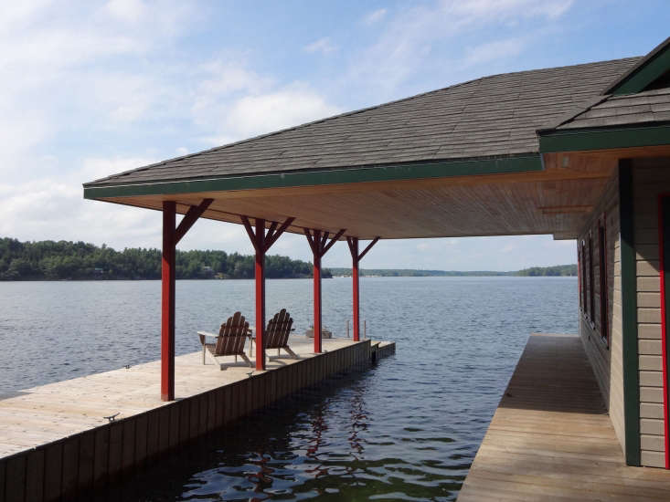 A new dock and covered boat storage adjoin the boathouse.