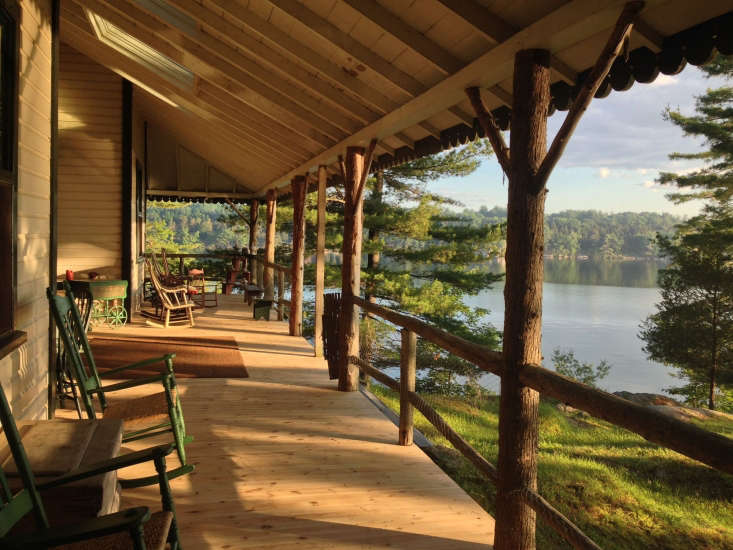 The covered porch of the main house is oriented to take advantage of water views.