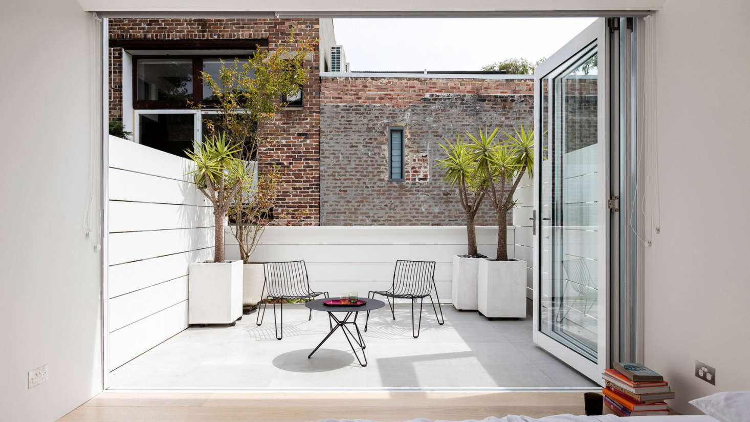 One floor above the kitchen, the master bedroom opens onto a terrace that overlooks the kitchen courtyard.