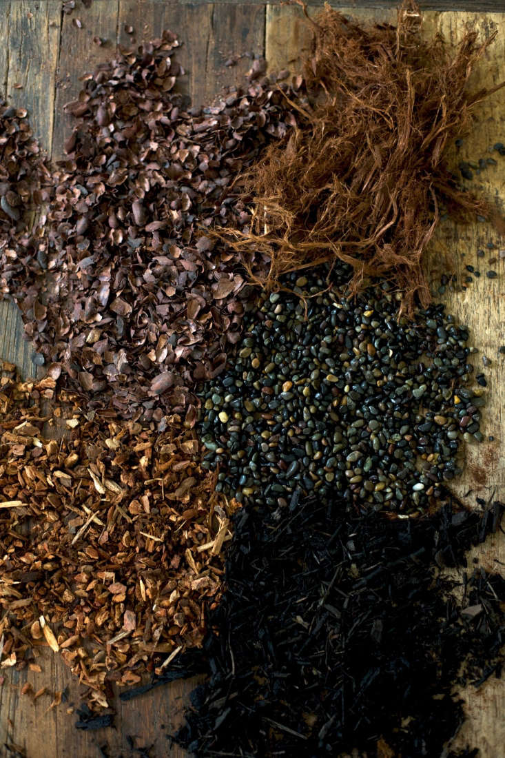 Mulched. Our favorite mulches include(clockwise, from bottom right) black bark, quarter-inch fir mini bark, cocoa bean hulls, shredded &#8