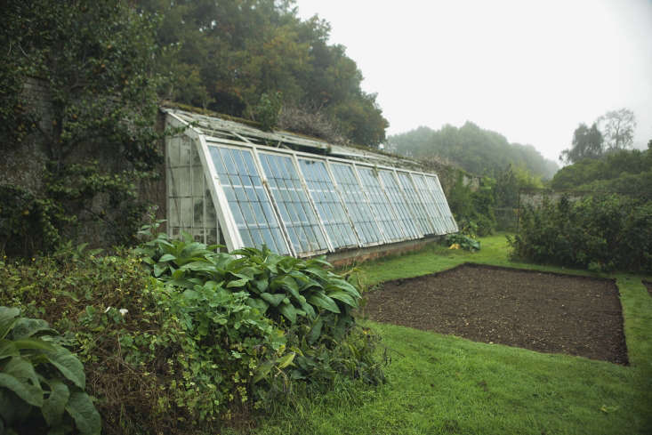 A too-big greenhouse in an English walled garden.