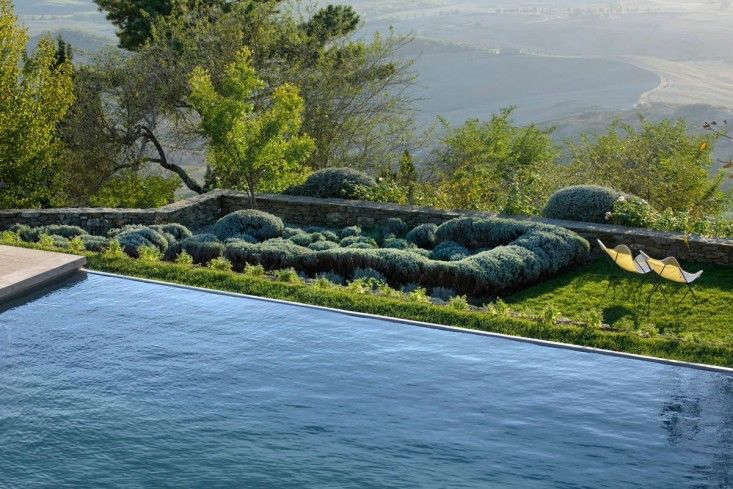 An infinity swimming pool with a panoramic view creates romance in Italy (as if Italy needs more romance). For more, see The New Dolce Vita: A Reinvented Village in Tuscany.