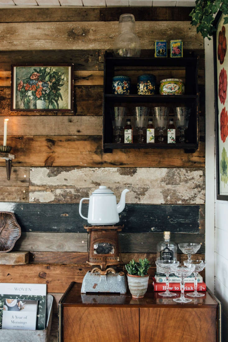For a been-there-forever English garden shed look, Jeska clad one interior wall in found boards.