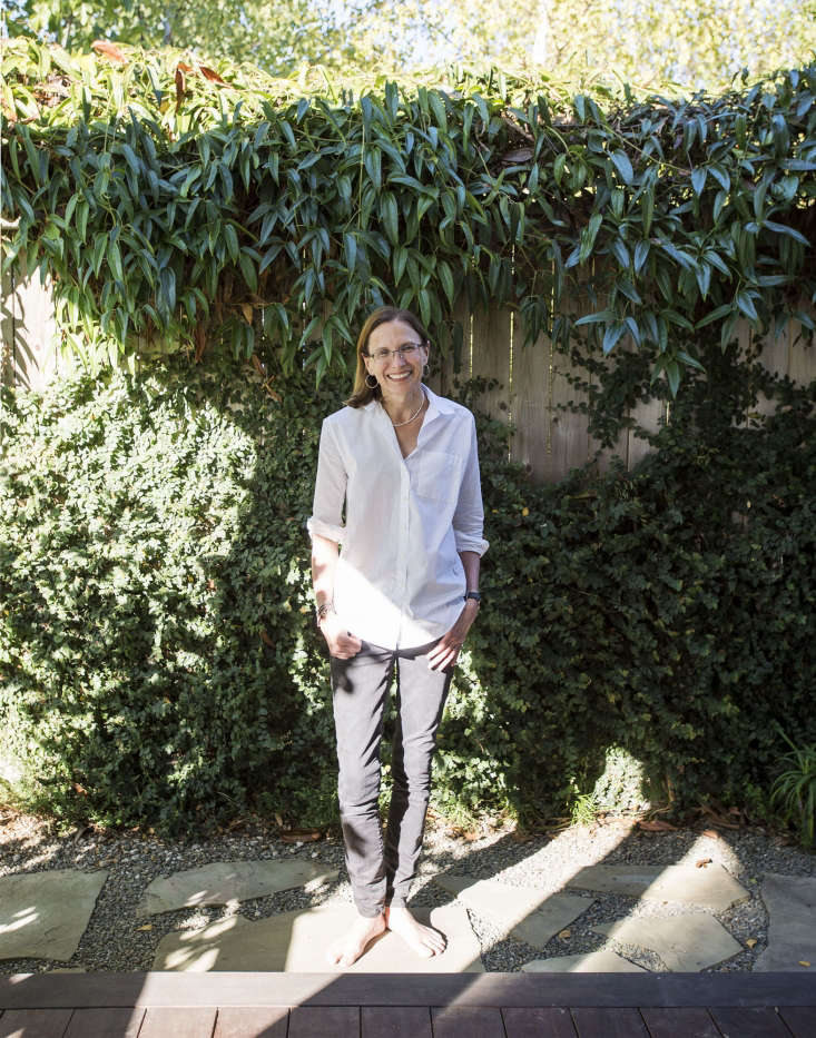 Architect Kelly Haegglund planted a layered garden, relying on different shades of green and foliage textures to create a sense of depth in the garden beds that edge the perimeter of her backyard.