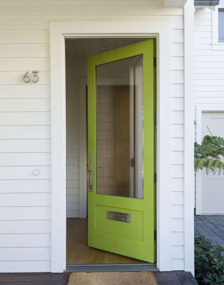 """Architect Kelly Haegglund&#8\2\17;s dramatic front door is painted with Benjamin Moore&#8\2\17;s Dark Lime, a color she chosebecause """"it's modern, and a complement to the greens and purples in the garden."""" See more in Garden Visit: At Home with Architect Kelly Haegglund in Mill Valley, California. Photograph by Matthew Williams."""