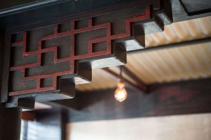 A reference to Chinese architecture in a doorway. The team recently traveled toChengdu and Shanghai for design—and menu—inspiration.
