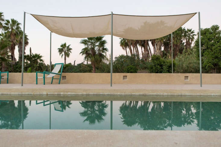 A simple shade sail protects sunbathers from mid-day rays.