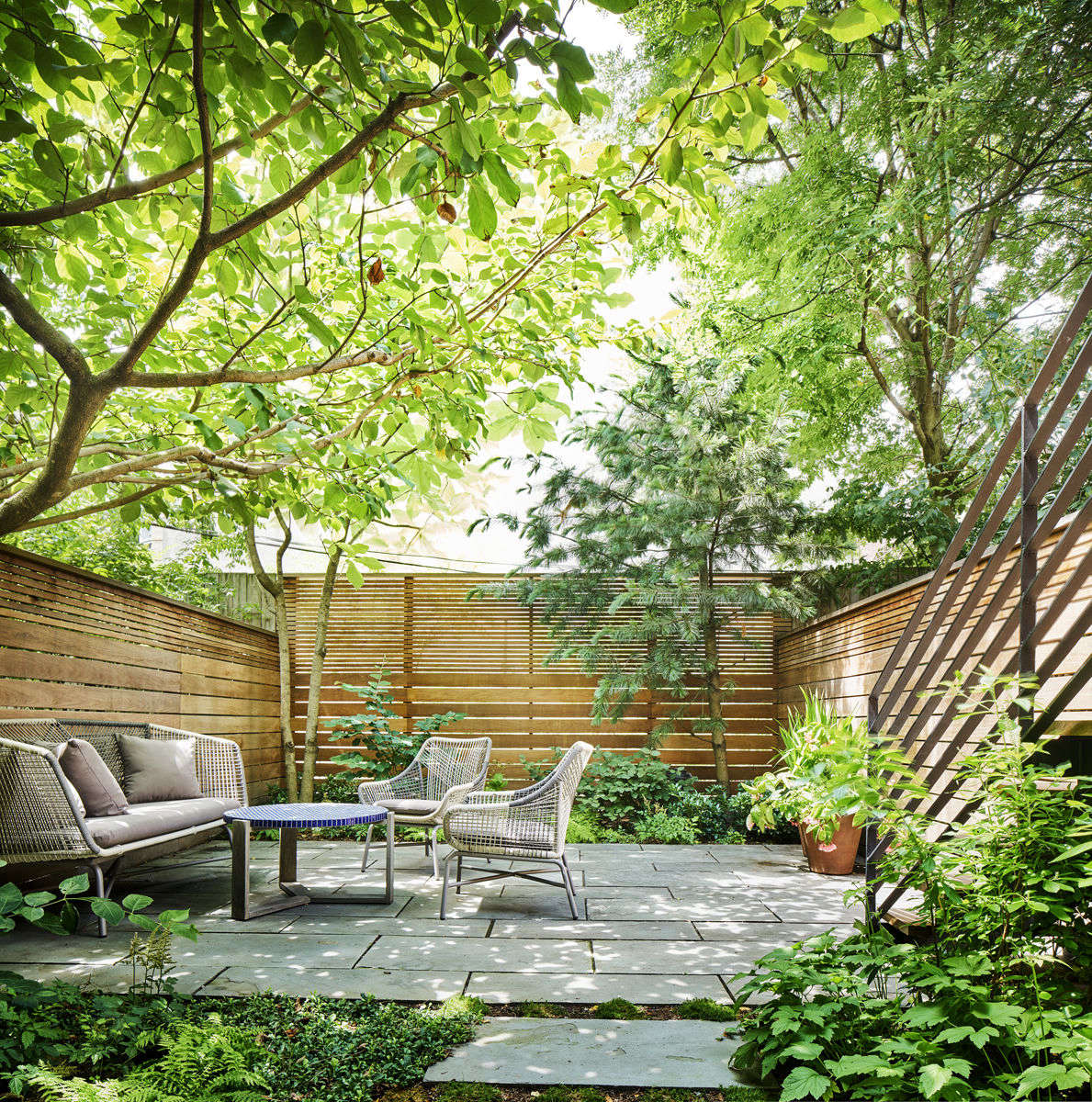 See more of this ipe fence in Landscape Architect Visit: A Leafy Garden in Park Slope in Brooklyn. Photograph by Dan Wonderly, courtesy of Kim Hoyt Architects.
