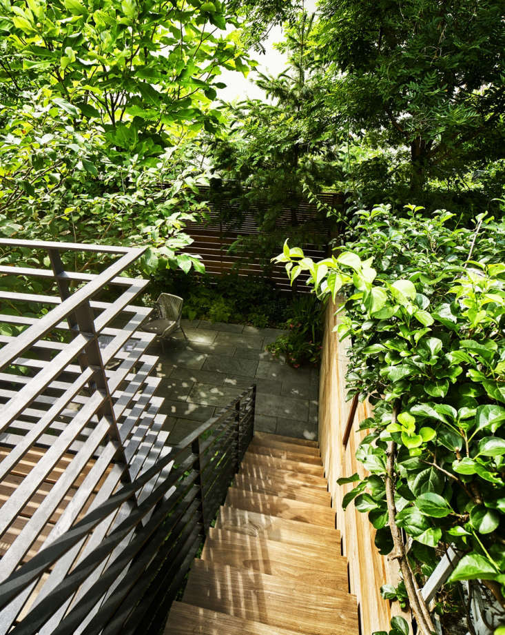 The stairway, deck, and fence are all made of water-repellent ipe wood and fabricated by Gogoleyed.The railing is painted steel, fabricated by All City Ironworks.