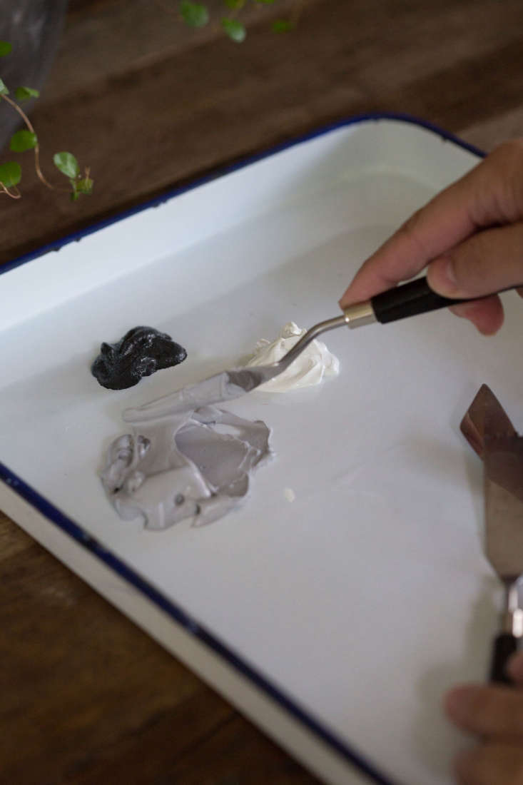 A palette knife can help control sticky caulk.