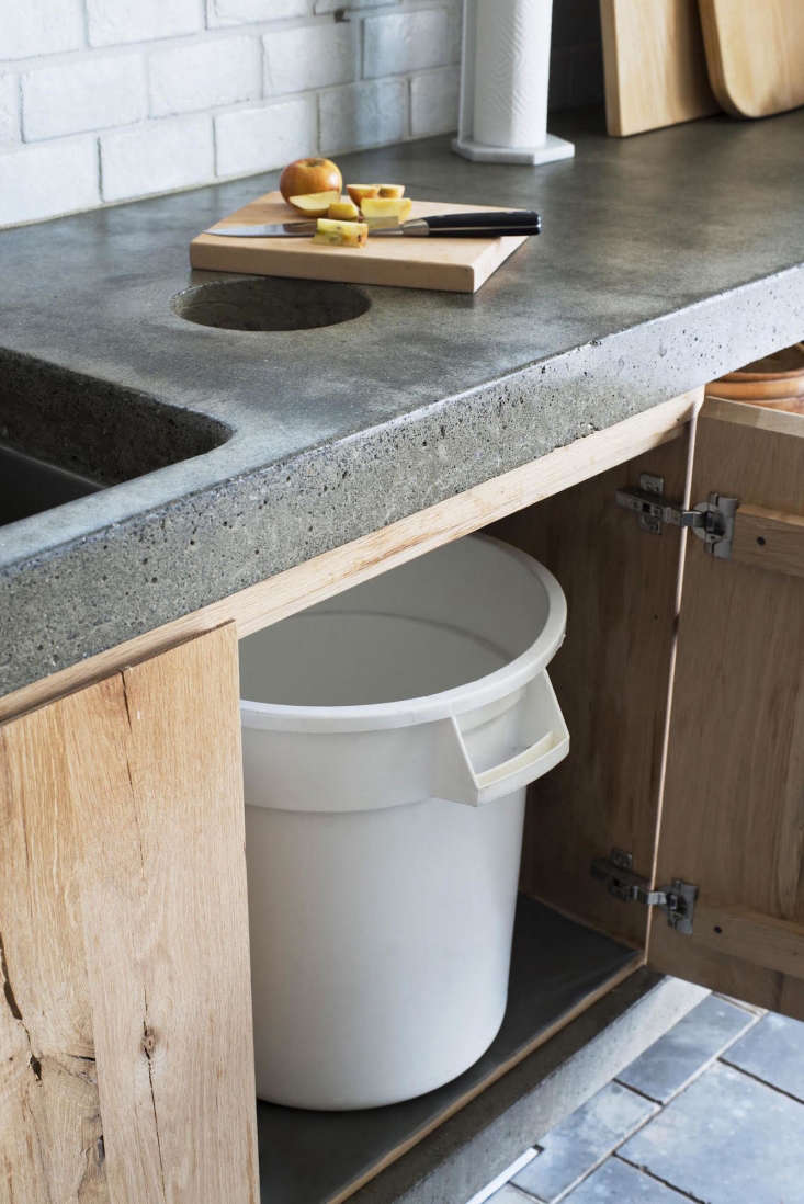 A custom compost chute is built into a poured concrete countertop (as also shown in the top photo of the post) at Scribe Winery in Napa Valley. Photography by Andres Gonzalez.