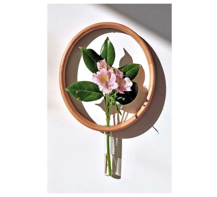 The allure of an empty frame: New York-based Kókili Projects&#8\2\17; Mary&#8\2\17;s Vaseturns flowers into art, witha single stemwithin a wooden frame.