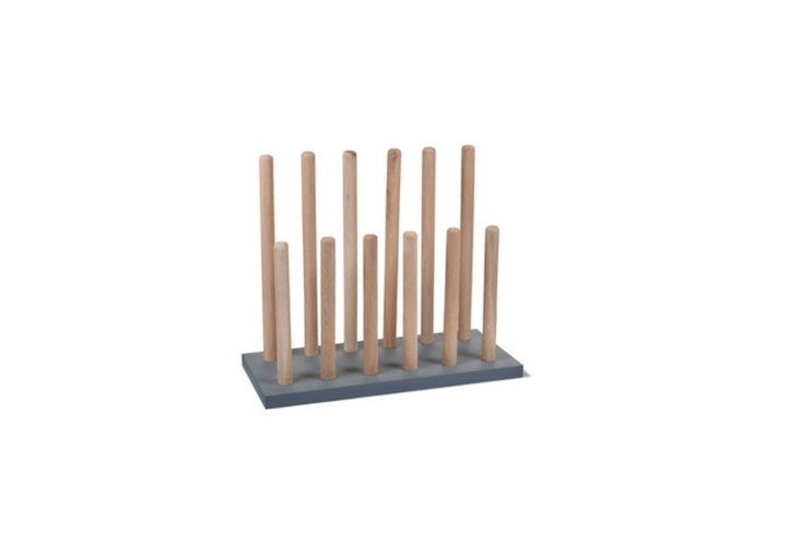 Garden Trading&#8\2\17;s Wooden Welly Rack, £50, has natural oak pegs and a charcoal base.