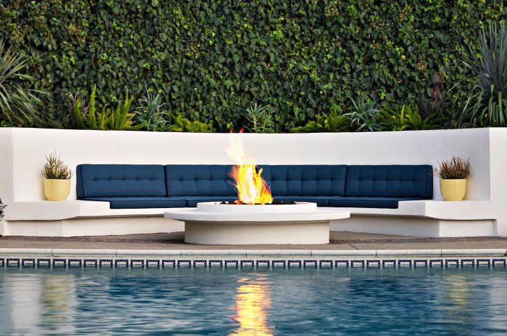 What's nice about a fire pit is that people can sit all the way around them—an outdoor fireplace generally doesn't allow that,&#8\2\2\1; says Judy. Photograph by Tom Mannion.