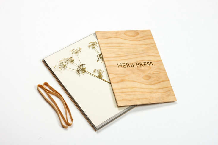 The herb and flower press comes in two sizes and two colors of wood, including natural as shown. A large Herb Press measuring loading=