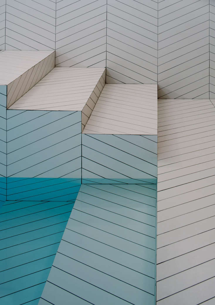 Without natural light, the white tiles in the indoor pool take on flattershades of turquoise.