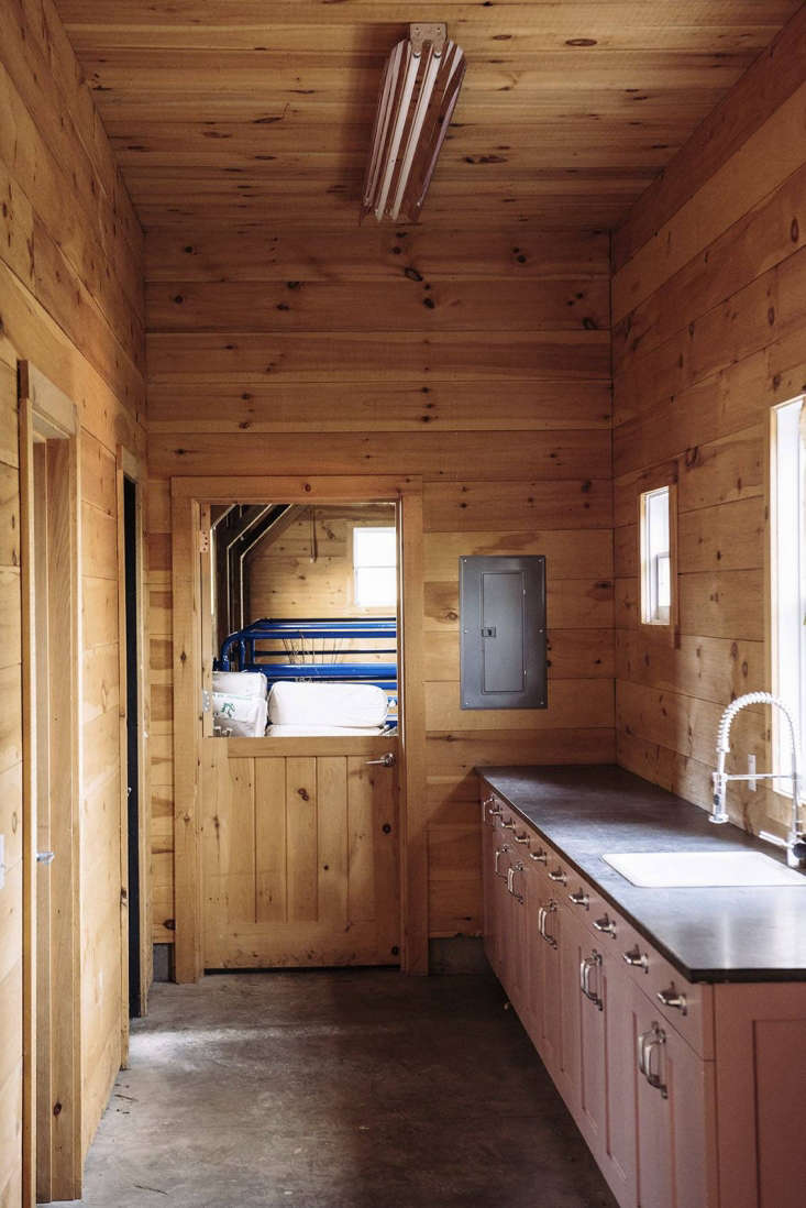 A mudroom with bathroom, laundry, and storage links the two wings of the barn. The wash-up cabinet has a soapstone countertop and is painted in Farrow & Ball&#8\2\17;s Cinder Rose—&#8\2\2\1;anappealingly slightly muddy pink, which in the light of the barn looks like it could have been from the \1940s,&#8\2\2\1; said Berman.