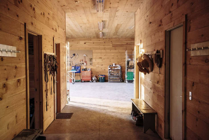 The hallway leads to theoffice, feed room, and cold storage.