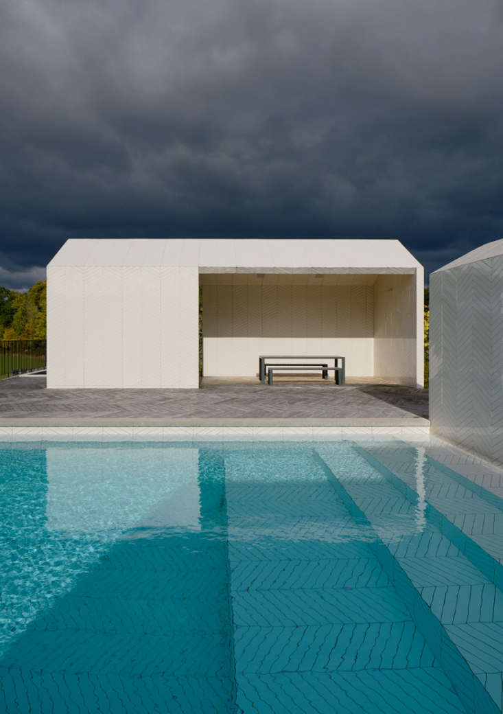 The designers embraced the pool water as part of the materials palette, intending for the white tile to take on increasingly dark turquoise hues as the pool stairs get deeper.