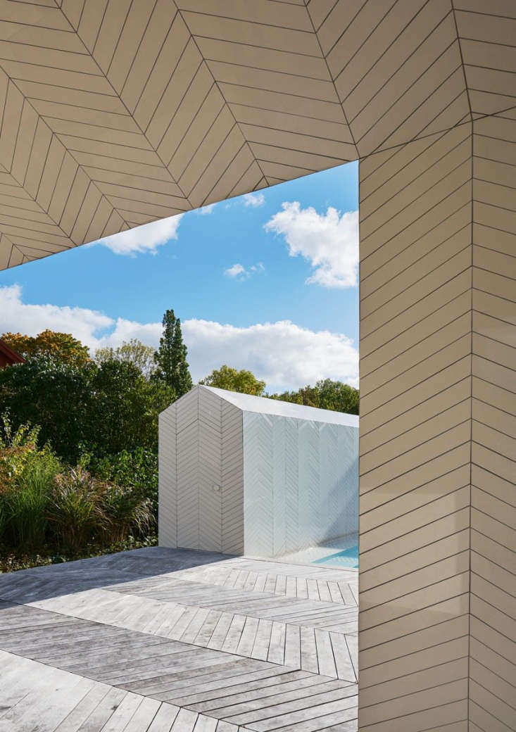 At each end of the smaller pavilion is a tiled door with pitched top and no casing—the silhouette of the pavilion itself in miniature.