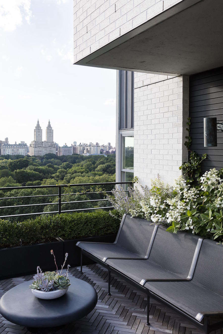 Mingling with white hydrangea (Hydrangea anomala petiolaris)in a planting box on a Manhattan balcony is N. faassenii 'Walker's Low'. See more inGarden Designer Visit: A Manhattan Terrace with Panoramic Central Park Views.Photograph courtesy ofNicholas Calcott.