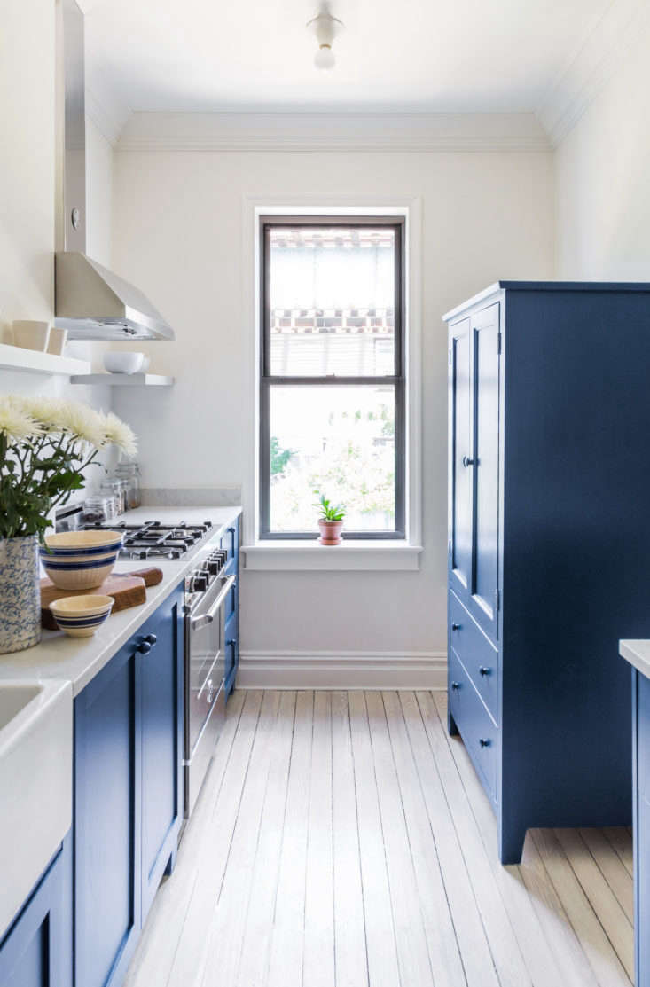 Blue cabinets, white walls, airy kitchen. See more in Before & After: A Buzzfeed Founder&#8\2\17;s Renovated Rowhouse.