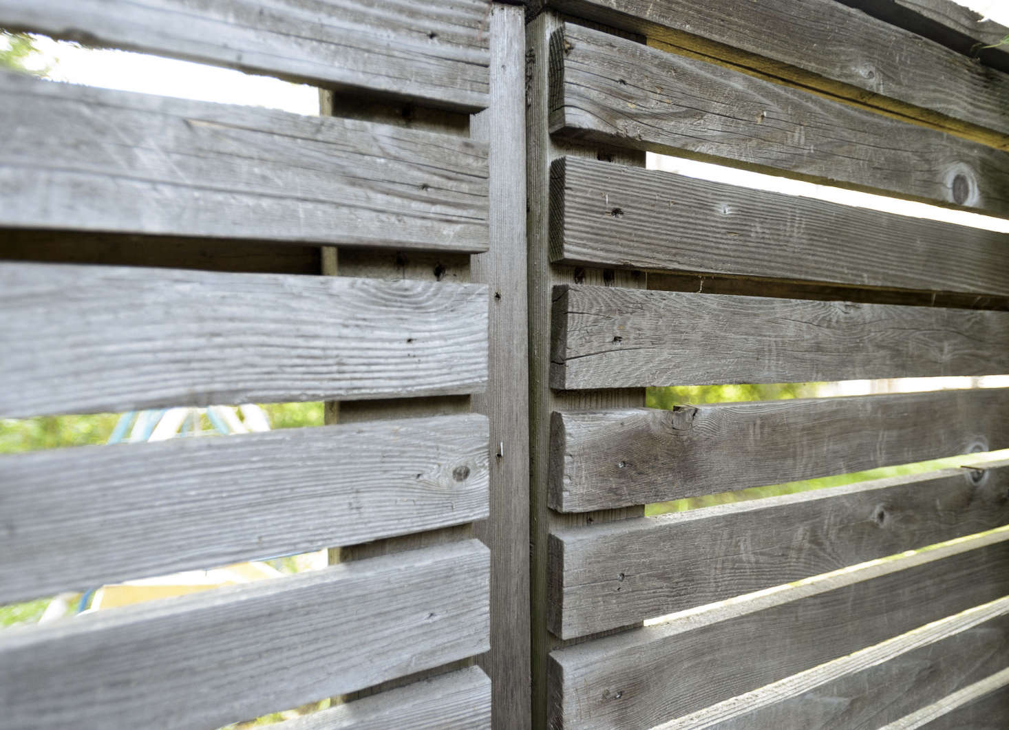 Open spaces between fence slats allow light to enter a garden, making a Brooklyn backyard feel airier.