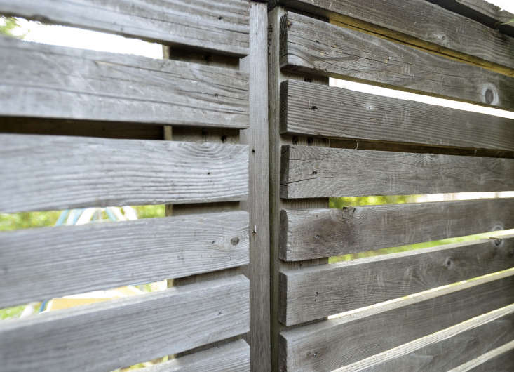 Open spaces between fence slats allow light to enter a garden, making a Brooklyn backyard feel airier.