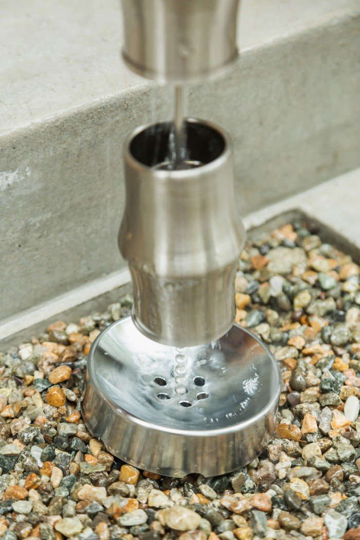 An Omori Rain Chain Weight made of brass connects through a ball chain and funnels water through seven drainage holes; $70 from SEO of Japan.