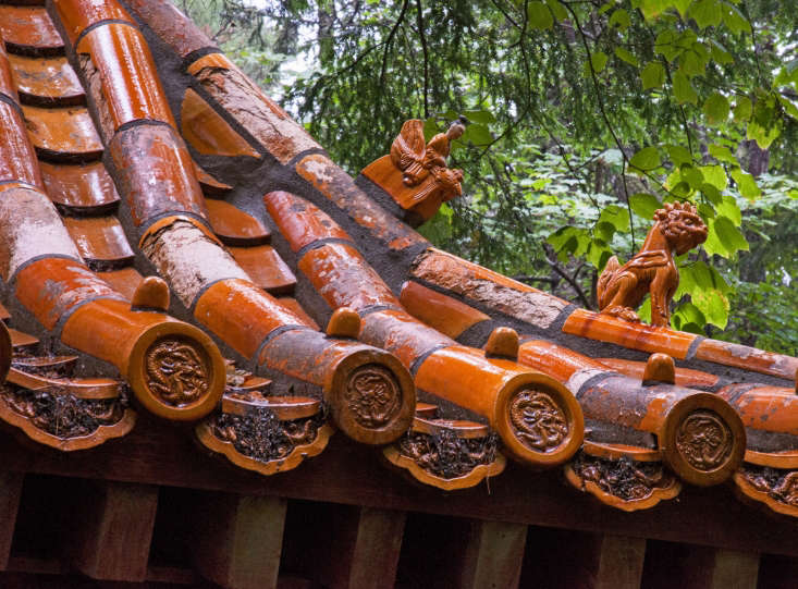 Roof tiles on the main entrance gate to the Abby Aldrich Rockefeller Garden were salvaged by the Rockefellers from a demolished wall in Beijing.