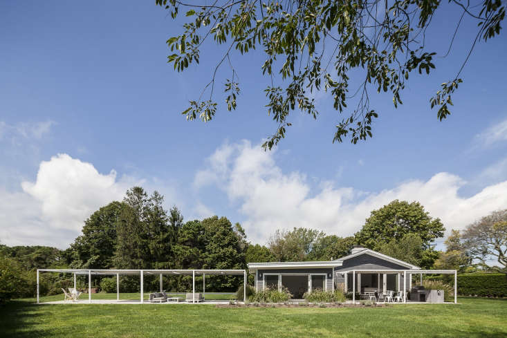 The clean lines of two covered verandas are extensions of theranch house.