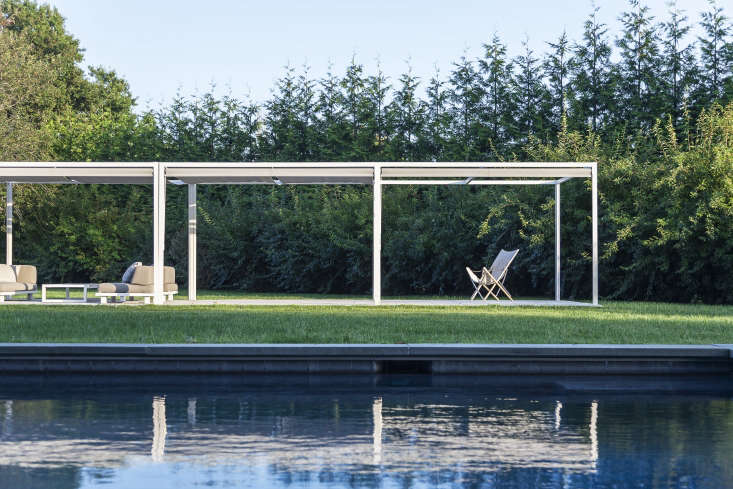Diving into July. Photograph fromBefore & After: A Swimming Pool in the Hamptons, Inspired by Spain.
