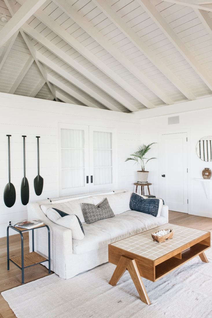 Wood-clad walls lend an airy look to A Vintage Hawaiian Cottage, Restored.Photograph by Kate Holstein.