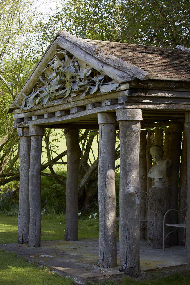 After taking several courses with Rosemary Verey at Barnsley House, Jessica Dickinson mastered the art of good structural design as well as horticultural technique temple and put the principles into play in the gardens at nearby Wortley House. Photograph by Britt Willoughby Dyer. For more, see Garden Visit: A Modern Garden for a Gothic Estate in the Cotswolds.
