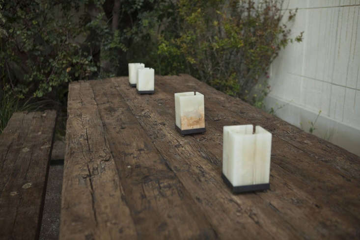 The four candle holders are like miniature limestone blocks.