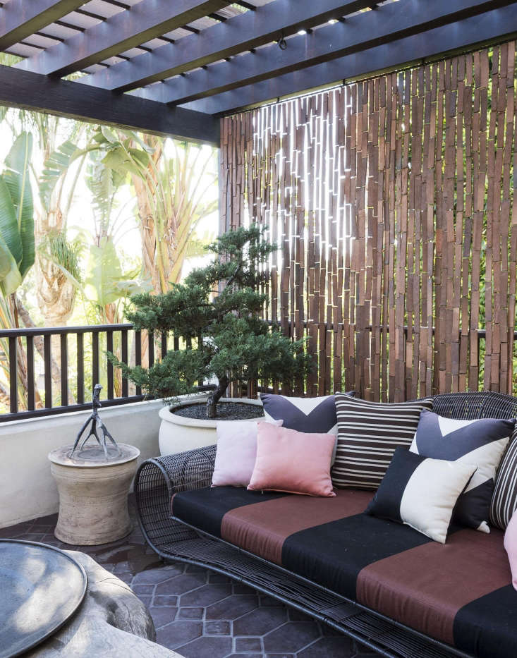 Artist Stan Bitters&#8\2\17;s clay wind chimes act as a screen to create privacy in a covered side porch in Los Angeles.