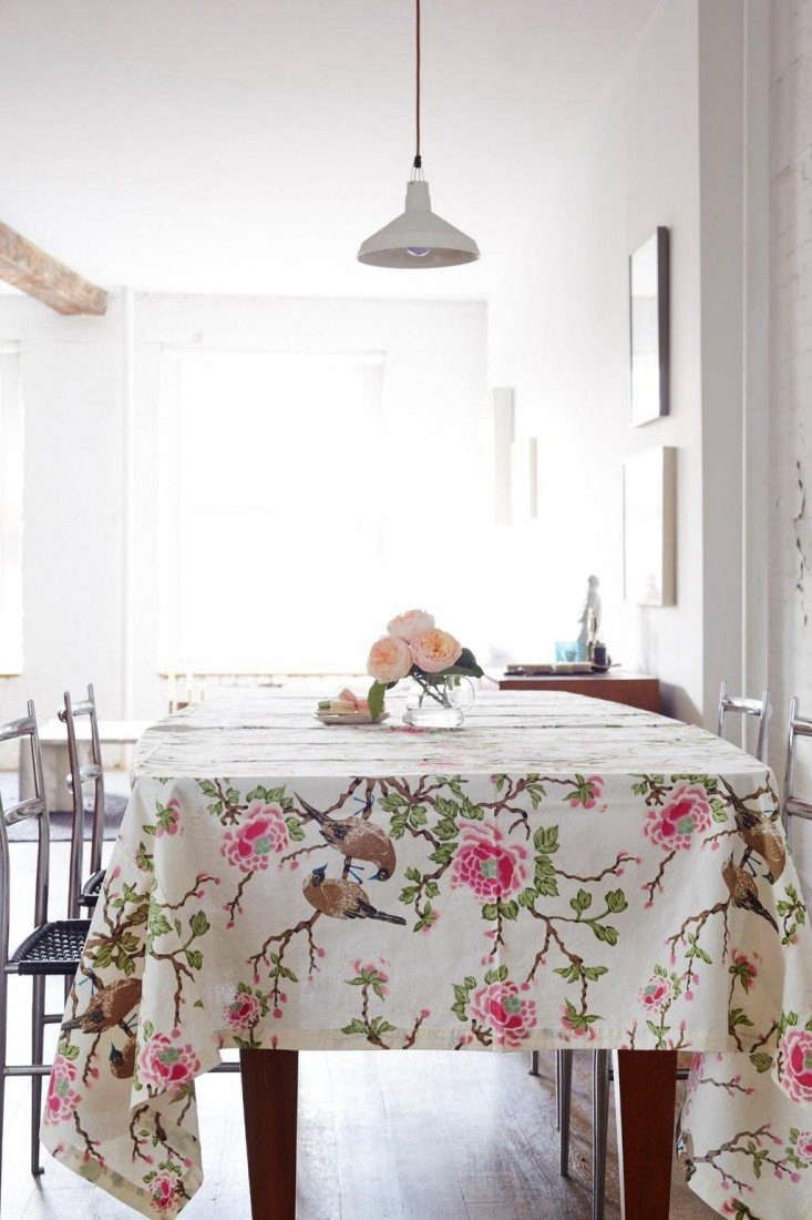 A Lovebird Cotton tablecloth by designer Erica Tanov; fabric is \$34 a yard.