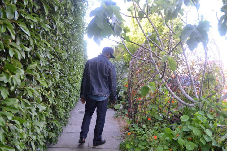 Finley walks in his sidewalk garden, which runs parallel to his home in South Los Angeles.