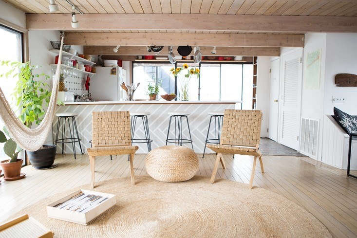 Natural fiber rugs, like this one in the houseboat home of Fredericks & Mae founders Gabe Cohen and Jolie Signorile, not only reflect the casual vibe of the coast but also they&#8