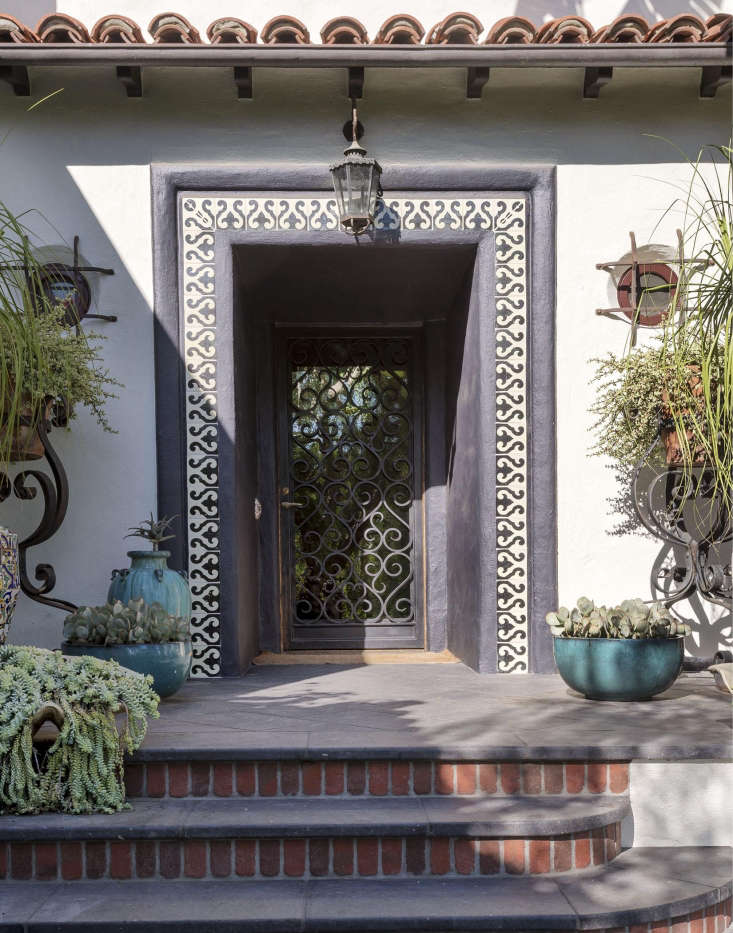 Designers (and siblings) Ramin and Pam Shamshiri added curb appeal to a s Hollywood garden with reclaimed ceramic patterned tile on a stucco facade and redbrick detailing on an entry stairway.