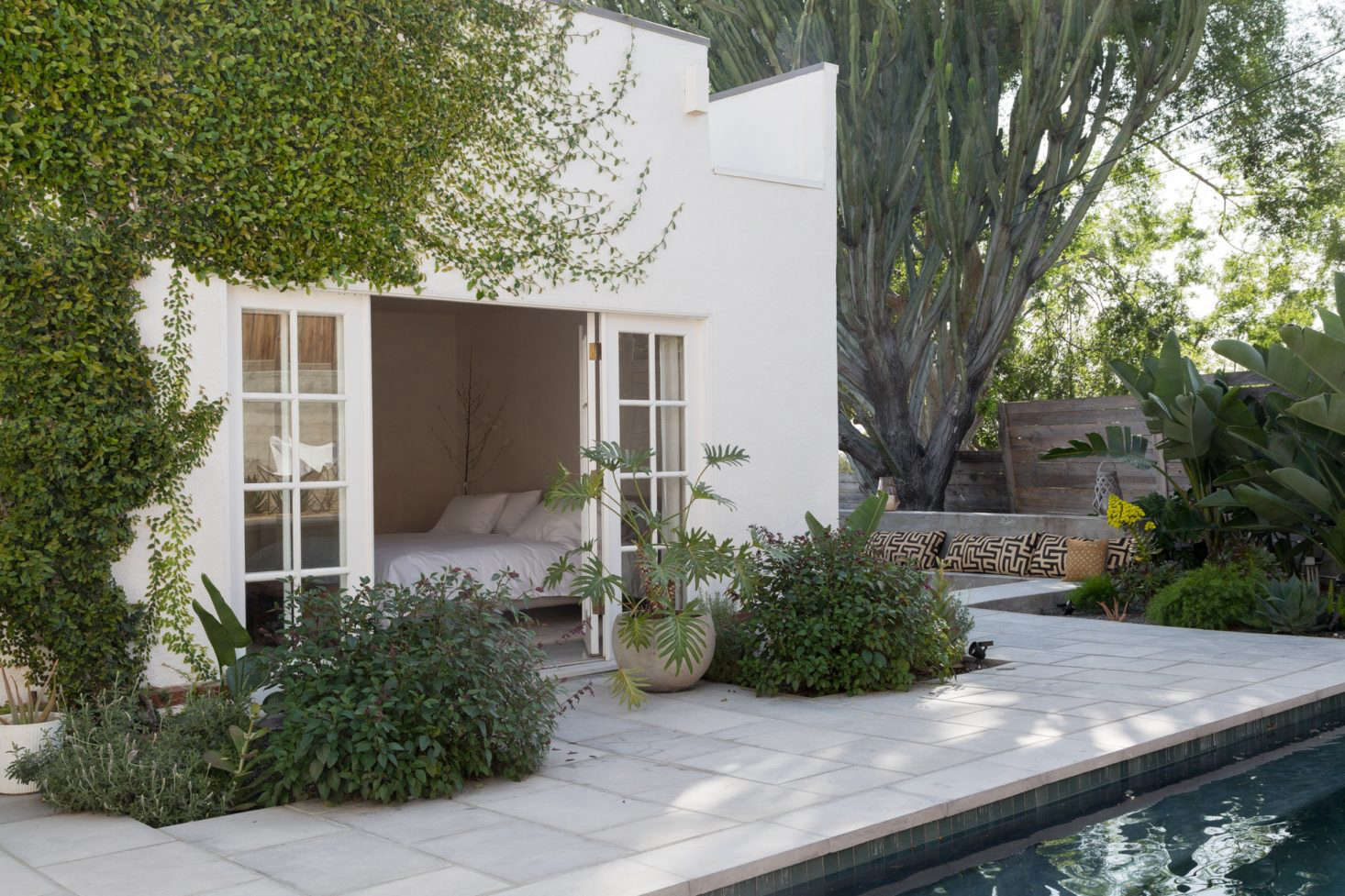 Another entry to the backyard: French doors lead from a first-floor bedroom to the pool.