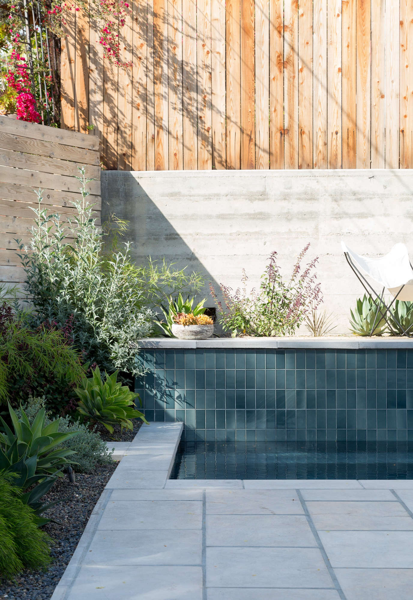 One raised side of the pool is tiled in Heath&#8