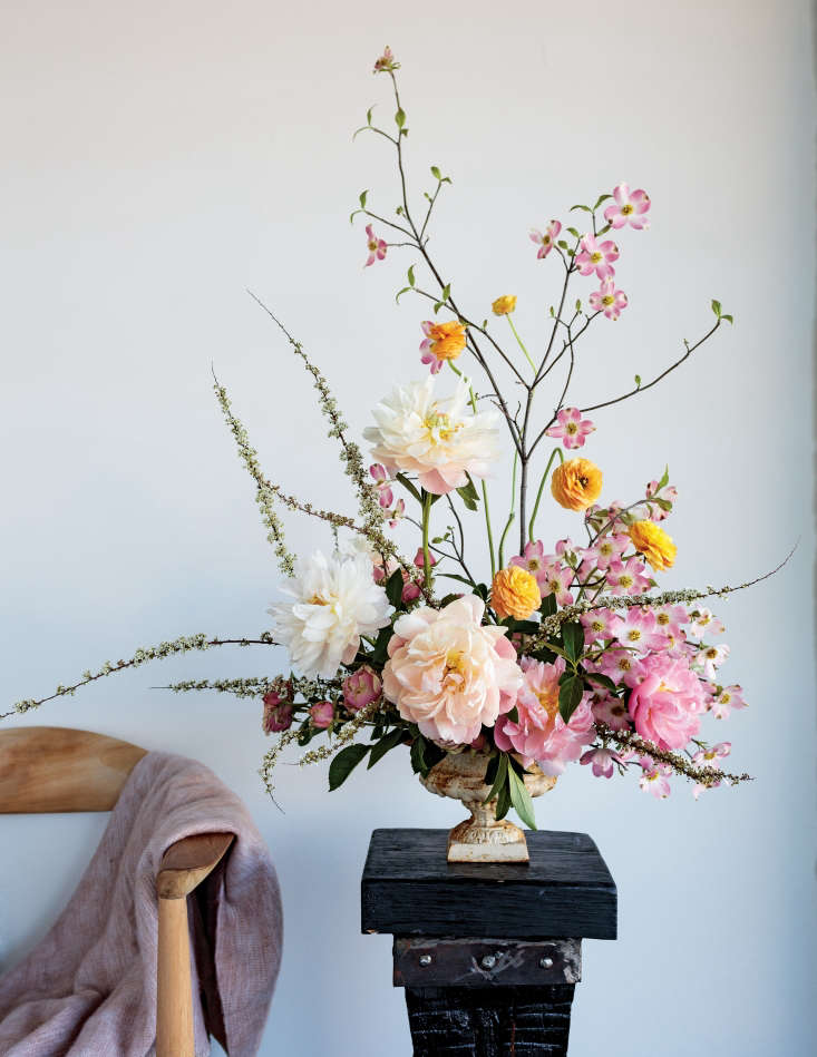 Floral artist Holly Carlisle, inspired by abstract painters such RobertRauschenberg and Cy Twombly, reinvents Ikebana, as seen in this precise but playful composition of roses, dogwood, and other beauties.