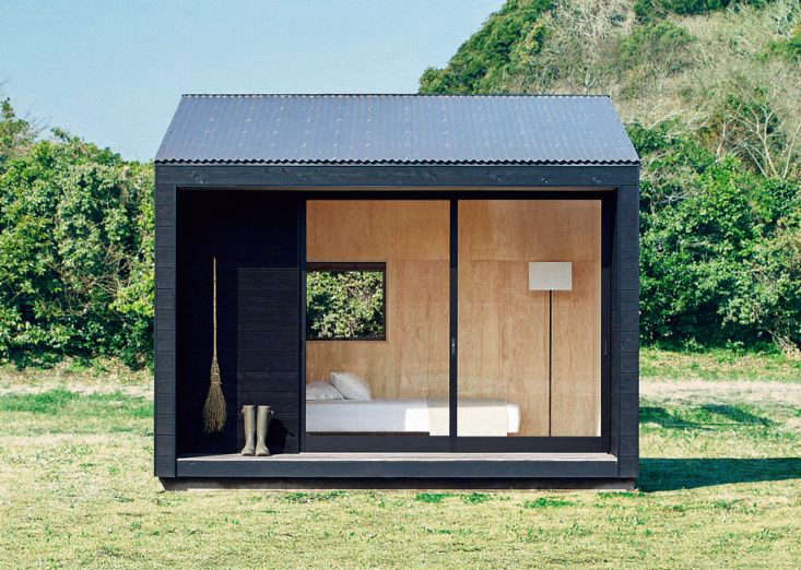 The prefabMuji Hutis small with an interior footprint of 98 square feet, &#8\2\20;but the porch and the high shed roof create a space large enough for 3–4 people to relax in,&#8\2\2\1; notes Muji. &#8\2\20;The large window at the entrance was originally made to be a shop's sliding door. Light and wind visit through another smaller window.&#8\2\2\1;