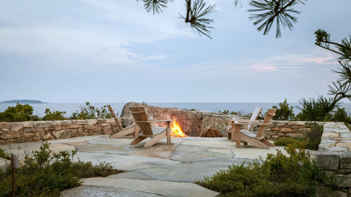 The angled boulder in front ofthe fire pit is the single largest rock placed on the site. The Adirondack chairs are from Crate & Barrel (though they&#8