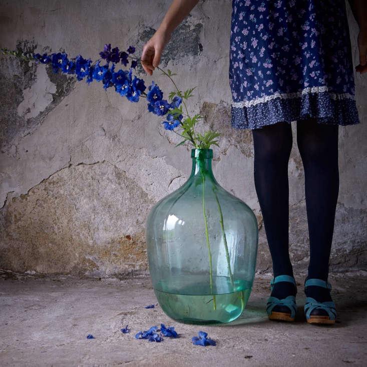 Rhapsody in blue; two delphiniums from the garden rest in a vintage wine jug in the barn.