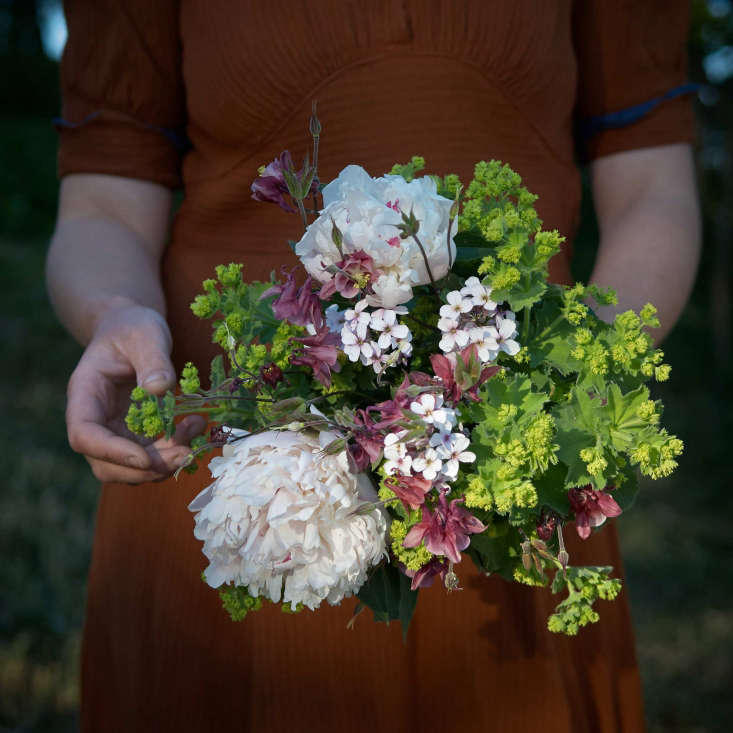 Picked from a friend&#8\2\17;s garden, a bouquet of peonies, columbine, lady&#8\2\17;s mantle, and dame&#8\2\17;s rocket complements one of Juliane&#8\2\17;s favorite \1940s dresses, a gift from a childhood neighbor.
