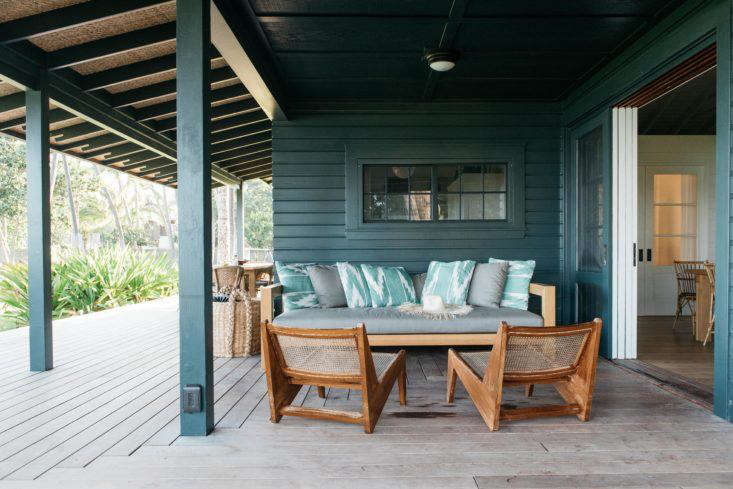 A deck extends the living are of this small beach cottage in Maui. Photograph by Kate Holstein, from Vacation Rental: Maui Beach Cottage with a Tropical Garden.