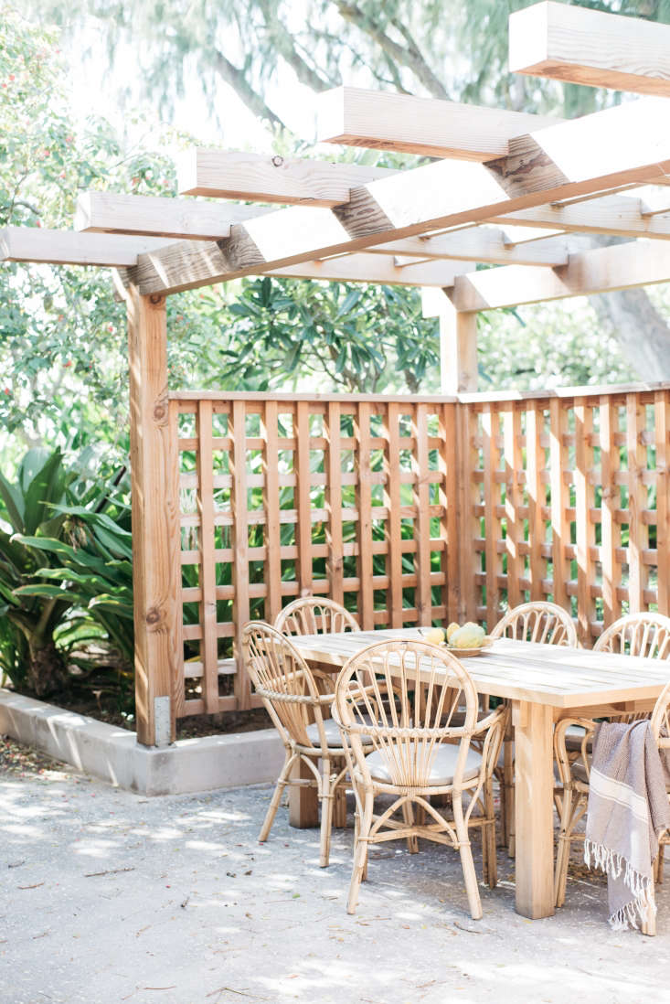 Beneath a pergola is another, more secluded dining area.